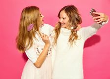 Two young stylish woman models in summer hipster clothes stock image