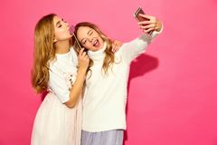 Two young stylish woman models in summer hipster clothes stock photos