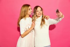 Two young stylish woman models in summer hipster clothes stock photography