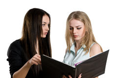 Two young successful girl with a folder Stock Images