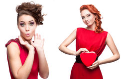 Two young surprised women in red dress Royalty Free Stock Images