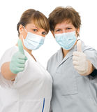 Two young sweet doctor. Showing whit finger OK Royalty Free Stock Photography