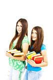 Two young teenage girls with colored books Stock Images