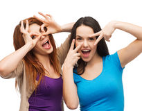 Two young teenagers making faces Royalty Free Stock Photo