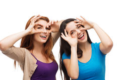 Two young teenagers making faces Stock Photography