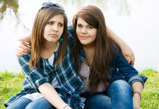 Two young teens. Feel sad on the lake Stock Photo