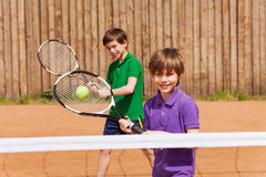 Two young tennis players waiting for a ball Stock Photography