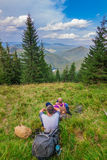 Two young tourist in mountains resting Synevyr Carpathians, Ukraine. Royalty Free Stock Images