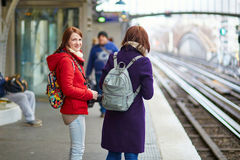 Two young tourist in Parisian subway Royalty Free Stock Photos