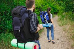 Two Young Tourists With Backpacks. Freedom and active lifestyle concept stock photos