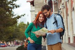 Two young tourists with backpacks sightseeing city. Travel concept. Hipster style people Stock Photo