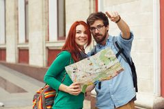 Two young tourists with backpacks sightseeing city. Travel concept. Hipster style people Royalty Free Stock Photo