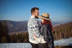 Two young travellers hugging in the mountains stock photos