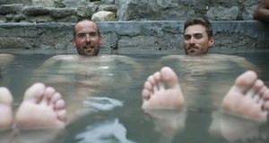 Two young trekkers enjoying hot spring Royalty Free Stock Photography