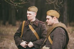 Two young unidentified re-enactors dressed as Royalty Free Stock Image