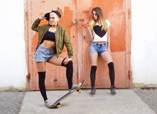Two young urban hipster girls posing Stock Photos