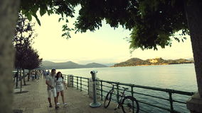 Two Young valentine People Boy and Girl are Holding Hands. Italy, August 2015 in Arona City HD Slow motion. Two Young valentine People Boy and Girl are Holding stock video