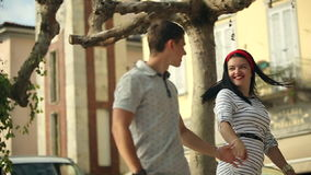 Two Young valentine People Boy and Girl are Holding Hands. Italy, August 2015 in Arona City HD Slow motion. Two Young valentine People Boy and Girl are Holding stock video footage