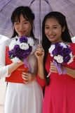 Two young vietnamese women Royalty Free Stock Photo