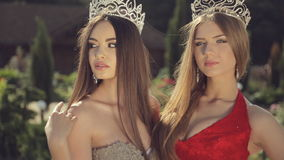 Two young winners of the beauty contest in the. Crowns in the park stock video