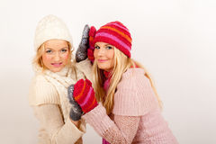 Two young winter girls friends in gloves Royalty Free Stock Photo