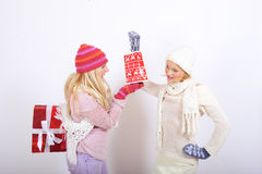 Two young winter woman with christmas presents Royalty Free Stock Photography