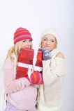 Two young winter woman with christmas presents Stock Images