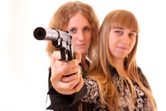 Two young woman aiming together Stock Image