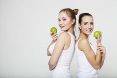 Two young woman with apples. Two young women with green apples Royalty Free Stock Photography