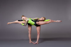 Two young woman as acrobats exercise pair program Stock Photography