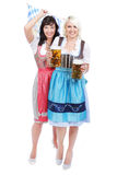 Two Young woman with beer glass. Two Young women with beer glass and bretzel in traditional costume royalty free stock image