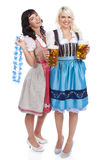 Two Young woman with beer glass. Two Young women with beer glass and bretzel in traditional costume stock photos