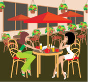 Two young woman in cafe. Royalty Free Stock Image