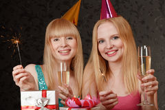 Two young woman celebrating Stock Photos