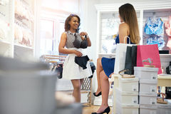 Two young woman choosing lingerie in a store Stock Image