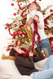 Two young woman with Christmas decoration Stock Photography