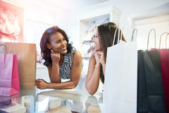 Two young woman in a clothing boutique Stock Image