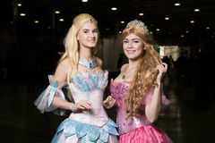 Two young woman cosplayer wearing beautiful dres Stock Image