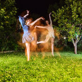 Two young woman dancing at night Royalty Free Stock Photos