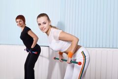 Two young woman doing exercises Stock Photo