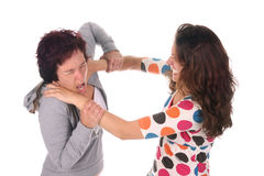 Two young woman fighting Stock Photos