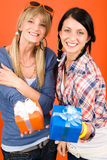 Two young woman friends hold party presents Royalty Free Stock Image
