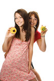 Two young woman with fruit Stock Images