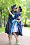 Two young woman graduate Royalty Free Stock Images