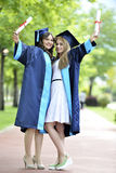 Two young woman graduate Royalty Free Stock Photography