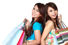 Two young woman happy holding shopping bags Stock Photos