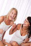 Two young woman having fun together Stock Photos