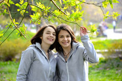 Two young woman having a walk in the park Stock Photography