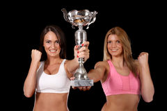 Two young woman holding trophy royalty free stock photography