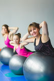Two young woman and little girl doing gymnastic exercises Stock Image